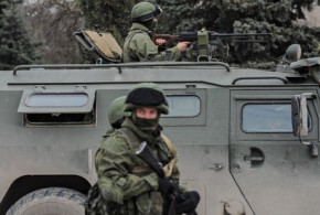 Troops in Russian military vehicles in Sevastopol in Crimea